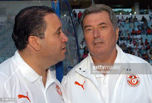 French head coach of the Tunisian team Roger Lemerre with assistant Nabil Maaloul during the football qualifying match for the World Cup 2010 African...