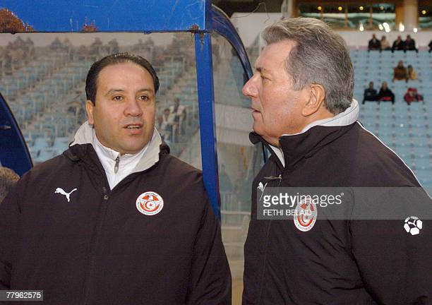 French head coach of the Tunisian team Roger Lemerre with his assistant Nabil Maaloul watch the freindly football match at Rades stadium 17 November...
