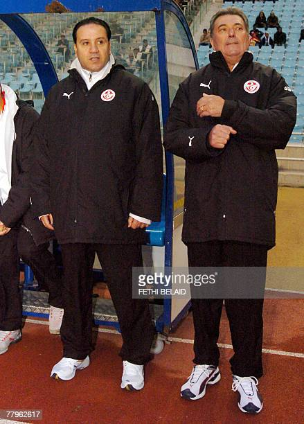 French head coach of the Tunisian team Roger Lemerre with his assistant Nabil Maaloul watch a freindly football match Tunisia vs Namibia at Rades...