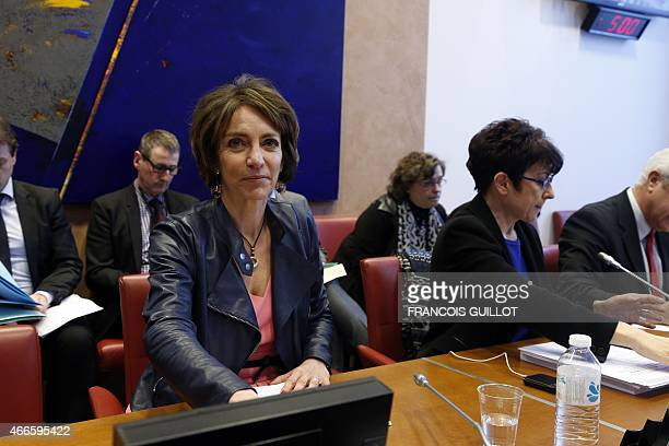 French Health and Social Affairs minister Marisol Touraine waits next to head of the Social Affairs commission at the National Assembly Catherine...