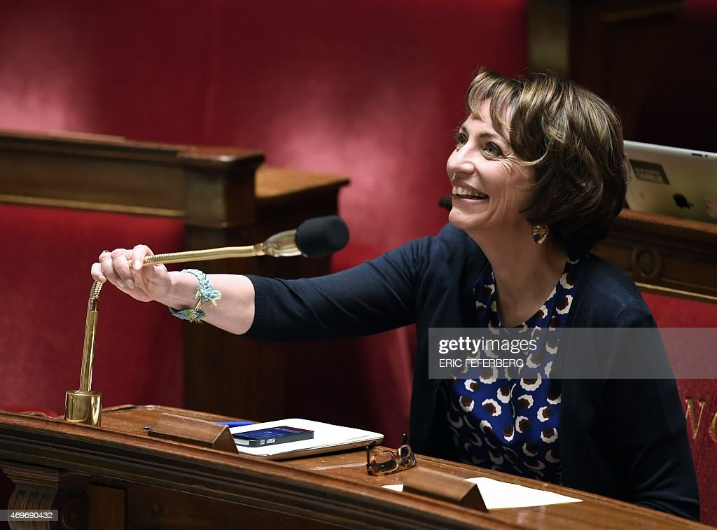 French Health Minister <a gi-track='captionPersonalityLinkClicked' href=/galleries/search?phrase=Marisol+Touraine&family=editorial&specificpeople=4398004 ng-click='$event.stopPropagation()'>Marisol Touraine</a> smiles as she adjusts a microphone during a discussion regarding a proposed health bill at the National Assembly in Paris on April 14, 2015.