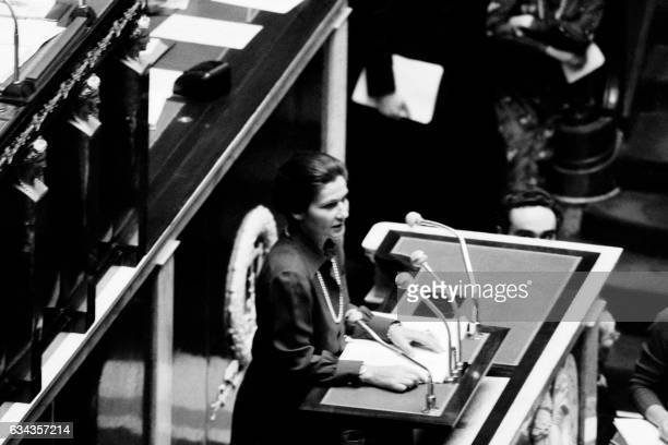 French health minister Simone Veil delivers a speech asking a law allowing abortion at the National Assembly on November 26 1974 in Paris / AFP /