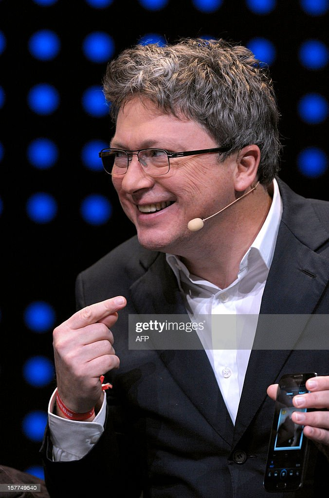 French Henri Seydoux, founder of CEO of wireless devices for mobile phones Parrot, talks during a session of LeWeb'12 in Saint-Denis, near Paris on December 6, 2012. AFP PHOTO ERIC PIERMONT