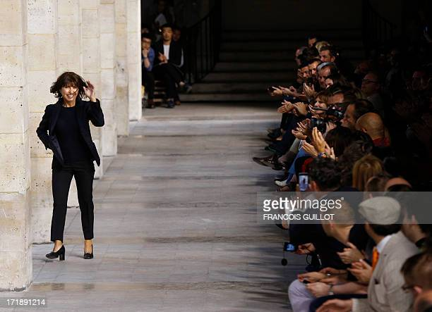 French Hermes designer Veronique Nichanian acknowledges the audience after presenting creations during the men's spring/summer 2014 readytowear...