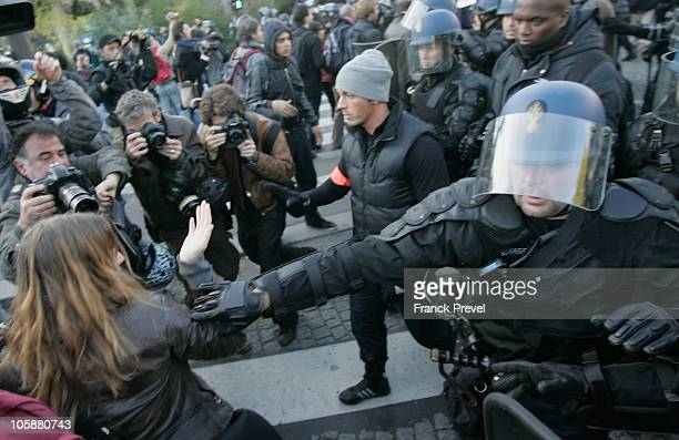 French high school students and workers clash after a demonstration over pension reform on October 21 2010 in Paris France France faced another day...