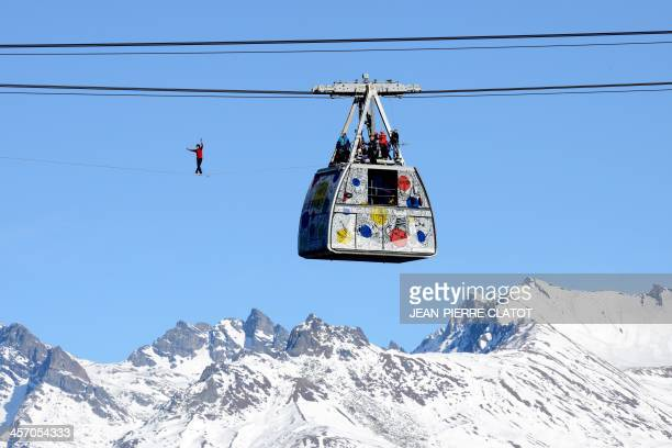 French highliner Julien Millot performs on the Paradiski cable way 380m high designed by French creator JeanCharles de Castelbajac on December 16...