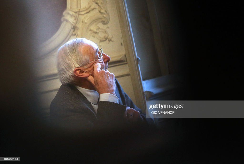 French historian and academician Jean-Pierre Babelon, specialist of French King Henri IV (1553-1610), listens during a press conference in Paris on February 12, 2013, to present the reconstruction of the head of Henri IV. This reconstruction was made three years after a panel of forensic scientists identified the skull of the king who was murdered at the age of 57 on May 14, 1610, by a fanatic. Scientists headed by France's Philippe Charlier found a common genetic profile between the mummified head of Henri IV and dried blood from his descendant, Louis XVI.