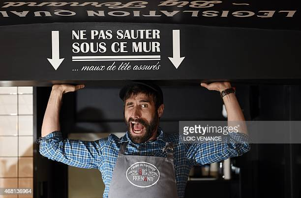 French holder and co founding member of the chain of fast food restaurants Big Fernand Alexandre Auriac poses in one of the restaurants on March 30...
