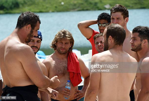 French hooker Dimitri Szarzewski talks to teammates after a raft contest as part of the French rugby union team's training camp in Tignes...