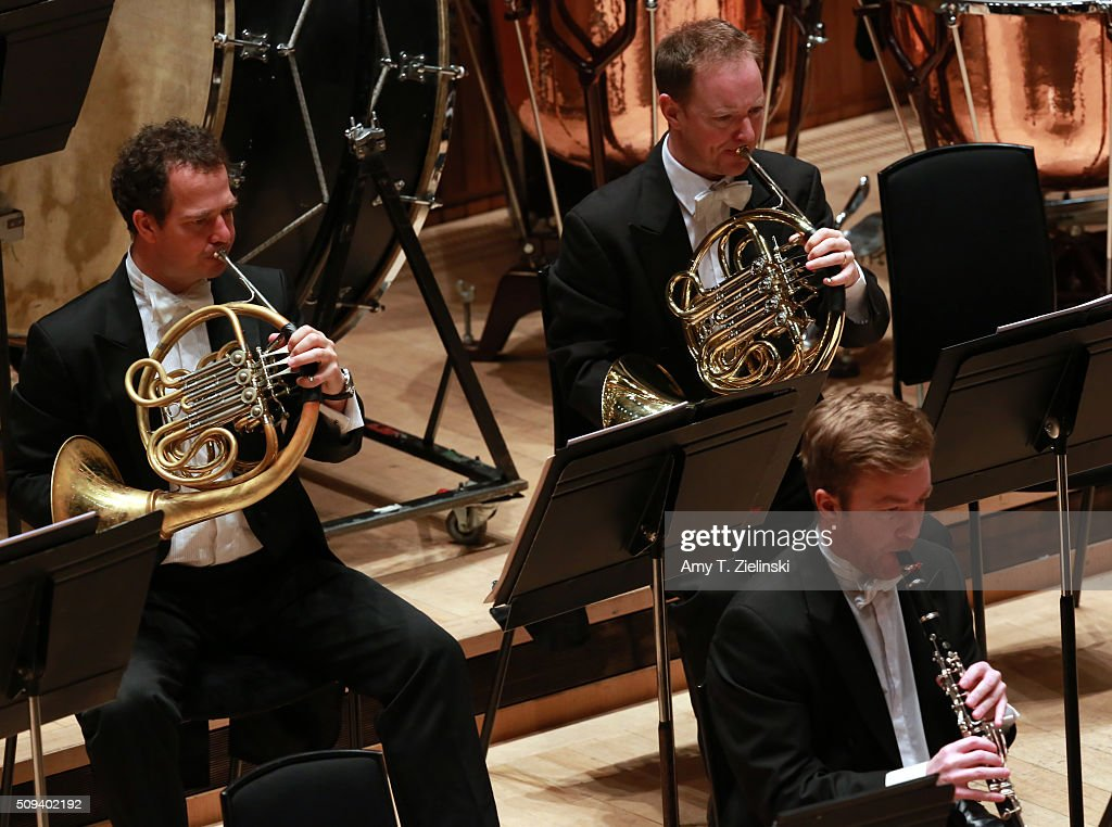 French Horn players perform as English pianist Stephen Hough plays at the piano as Finnish conductor Osmo Vanska leads the London Philharmonic Orchestra in composer Antonin Dvorak's Piano Concerto in G minor in the Southbank Centre's the Royal Festival Hall on February 10, 2016 in London, England.