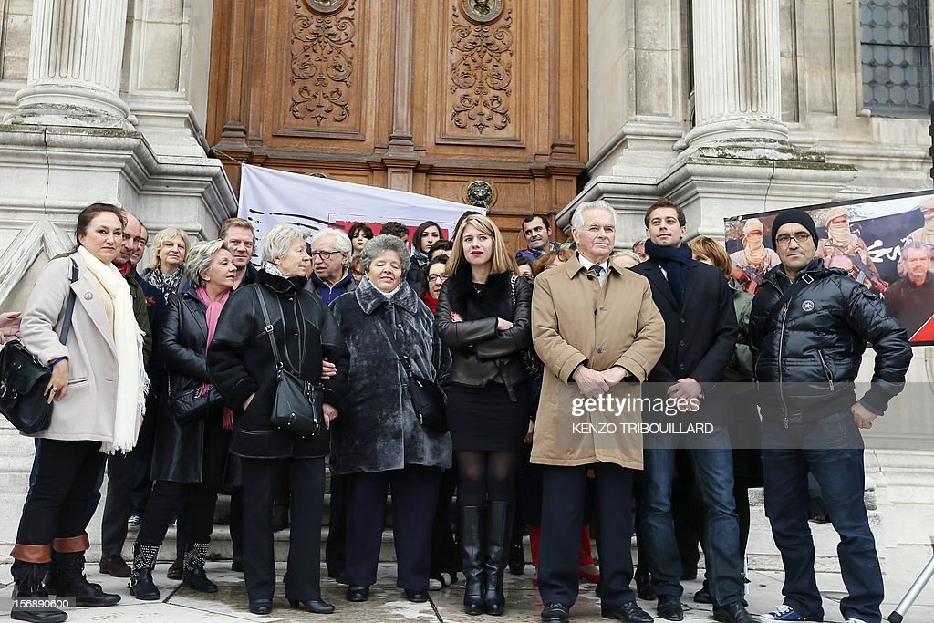 French hostage Philippe Verdon's father, Jean-Pierre Verdon (3edR), and French Diane Lazarevic, the daughter of French hostage Serge Lazarevic (4thR) pose with the members of the committee in support to businessman Philippe Verdon and engineer Lazarevic, two French hostages in Mali, on November 24, 2012 after a meeting in front of Paris' city hall, to mark the first anniversary of their abduction. Thirteen hostages are held by hardline Islamists in the region which has suffered a devastating collapse since a coup in Bamako in March. Seven of these are French. AFP PHOTO KENZO TRIBOUILLARD