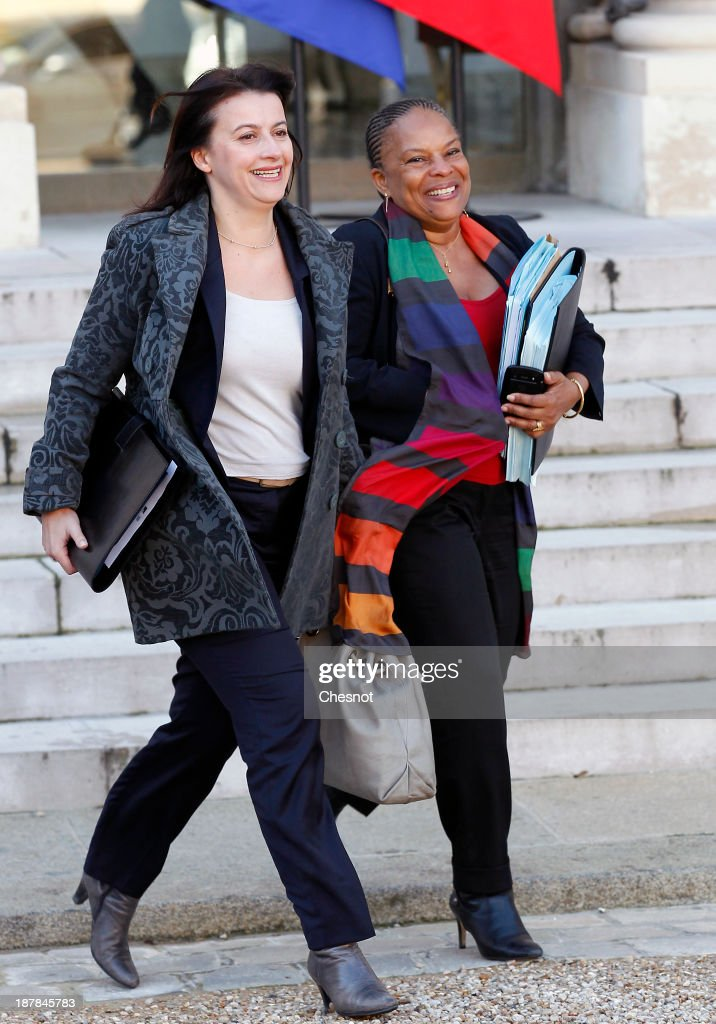French Housing Minister Cecile Duflot (L) and French Justice Minister <a gi-track='captionPersonalityLinkClicked' href=/galleries/search?phrase=Christiane+Taubira&family=editorial&specificpeople=3798541 ng-click='$event.stopPropagation()'>Christiane Taubira</a> leave the Elysee Palace after the weekly cabinet meeting on November 13, 2013 in Paris, France. The French government has opened a racism investigation after a far-right magazine cover compared the country's black justice minister to a monkey.