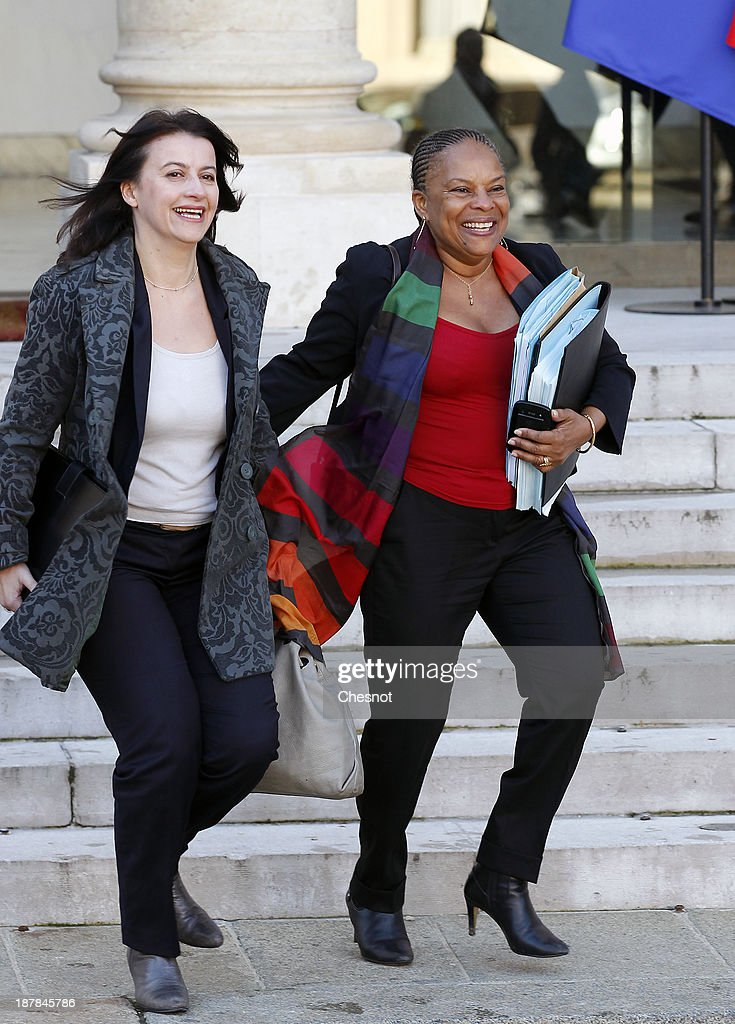 French Housing Minister Cecile Duflot (L) and French Justice Minister Christiane Taubira leave the Elysee Palace after the weekly cabinet meeting on November 13, 2013 in Paris, France. The French government has opened a racism investigation after a far-right magazine cover compared the country's black justice minister to a monkey.
