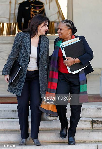 French Housing Minister Cecile Duflot and French Justice Minister Christiane Taubira leave the Elysee Palace after the weekly cabinet meeting on...