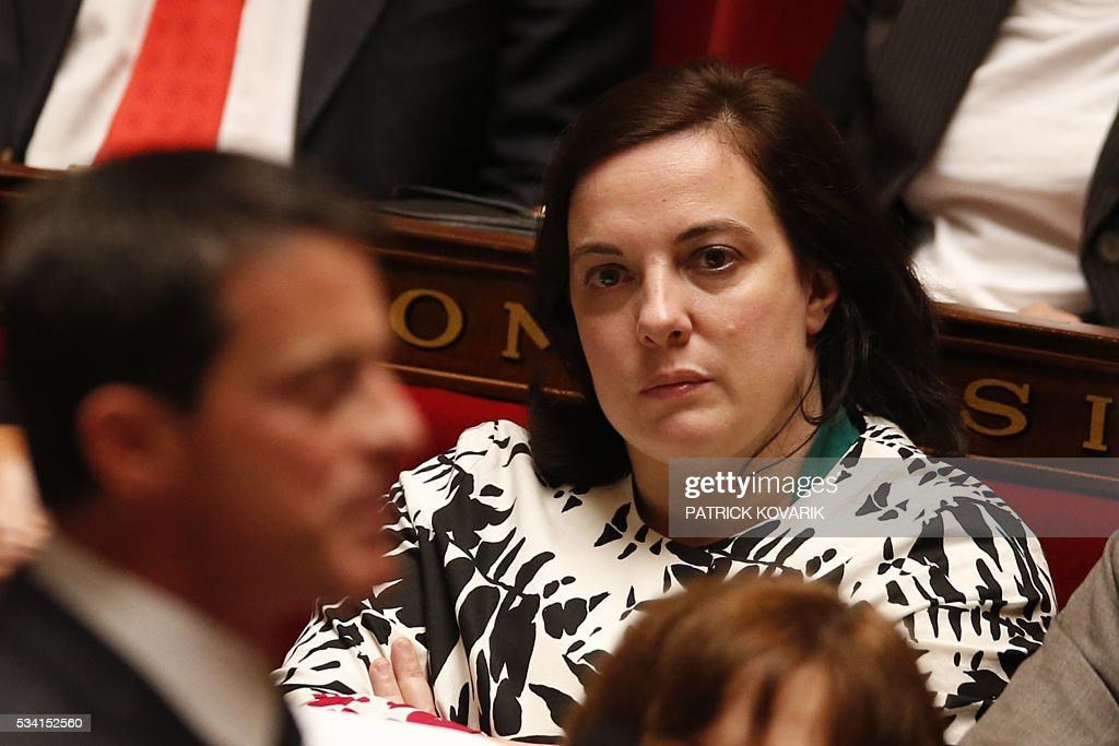 French Housing minister Emmanuelle Cosse looks at French Prime Minister during a session of Questions to the Government, on May 25, 2016 at the National Assembly in Paris.