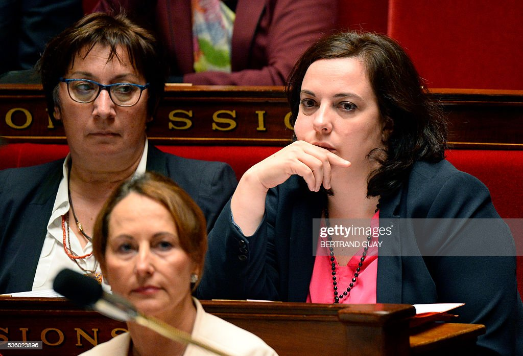 French Housing Minister Emmanuelle Cosse looks on next to French Junior Minister for Trade, Handicraft and Social and Solidarity Economy Martine Pinville (L) during a session of questions to the Government at the French National Assembly in Paris, on May 31, 2016.