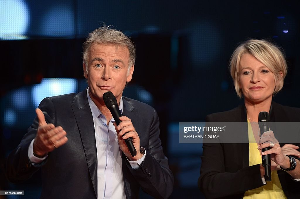 French humorist and godfather Franck Dubosc and French TV hosts Sophie Davant attend the 26th Telethon, France's biggest annual fund-raising event during 30 hours of live television transmission, on December 7, 2012 in Saint-Denis, north of Paris. The event, aiming at collecting funds for research on genetic diseases such as myopathy, a neuromuscular disease, will take place on December 7 and 8, 2012.