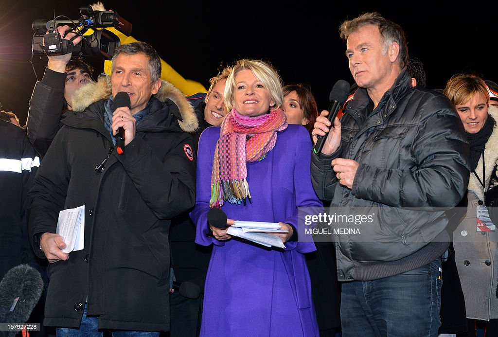 French humorist and godfather Franck Dubosc (R), TV hosts Sophie Davant and Nagui (L)speak to launch the 26th Telethon, France's biggest annual fund-raising event on December 7, 2012 in Paris. The event, aiming at collecting funds for research on genetic diseases such as myopathy, a neuromuscular disease, will take place on December 7 and 8, 2011. AFP PHOTO MIGUEL MEDINA