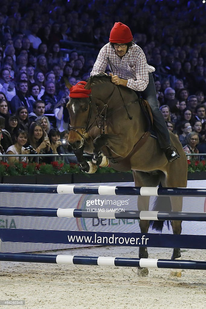 French humorist and radio host Nicolas Canteloup competes during the Style and Competition for Amade charity costumed event of the Paris Masters equestrian jumping competition on December 7, 2013 at the Parc des Expositions in Villepinte, north of Paris.