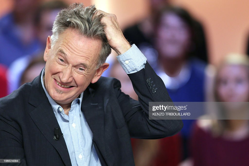 French humorist Benoit Delepine takes part in the TV show 'Le grand journal' on a set of French TV Canal+, on November 16, 2012 in Paris.