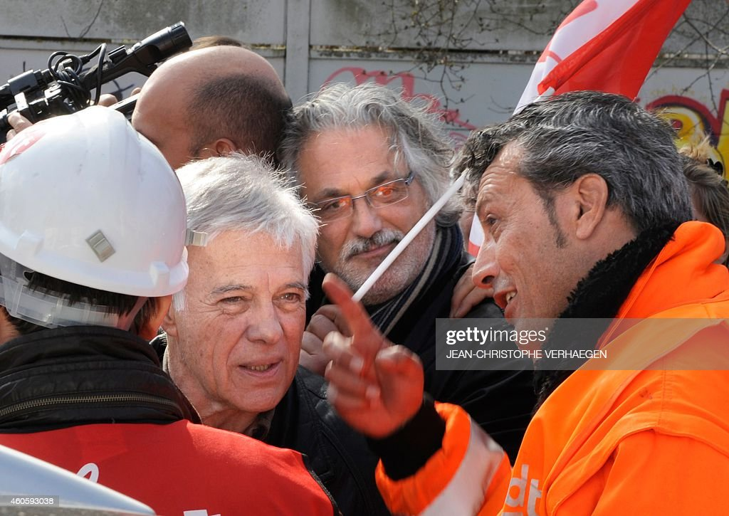 French humorist Guy Bedos speaks with CFDT union representative of ArcelorMittal steel company Edouard Martin on March 12 2012 in Florange...