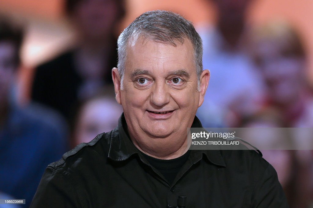 French humorist, Jules Edouard Moustic takes part in the TV show 'Le grand journal' on a set of French TV Canal+, on November 16, 2012 in Paris.