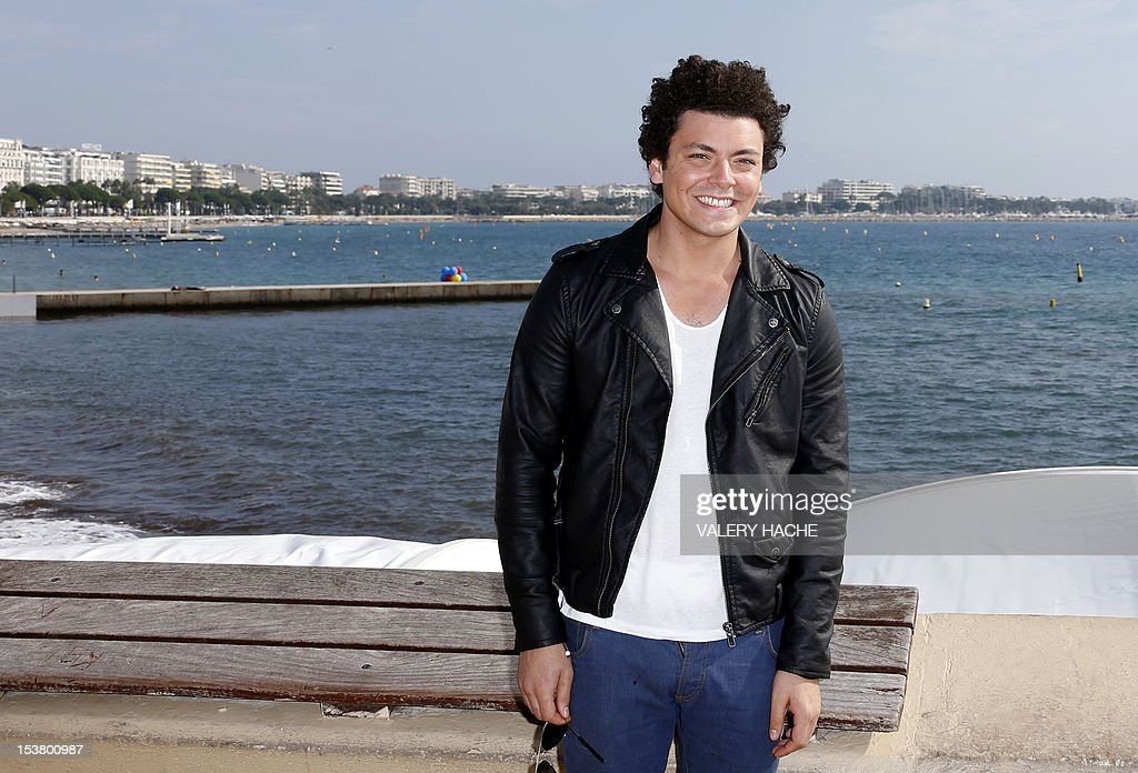 French humorist Kev Adams poses during a photocall for 'From Kev to Adam' as part of the Mipcom international audiovisual trade show at the Palais des Festivals, in Cannes, southeastern France, on October 9, 2012. AFP PHOTO / VALERY HACHE