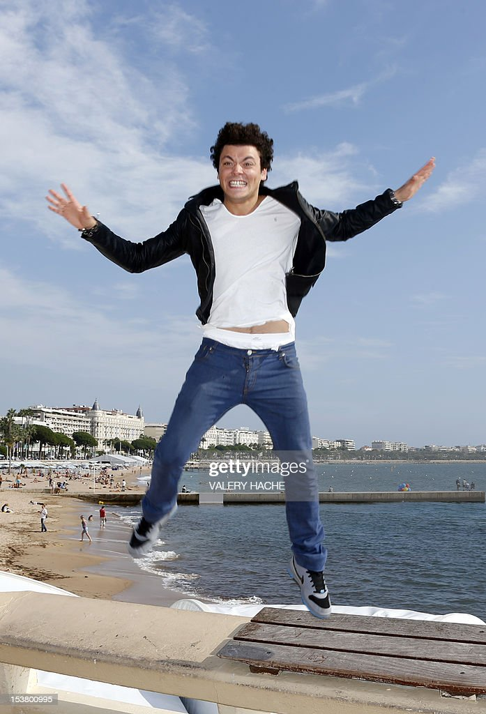French humorist Kev Adams poses during a photocall for 'From Kev to Adam' as part of the Mipcom international audiovisual trade show at the Palais des Festivals, in Cannes, southeastern France, on October 9, 2012.