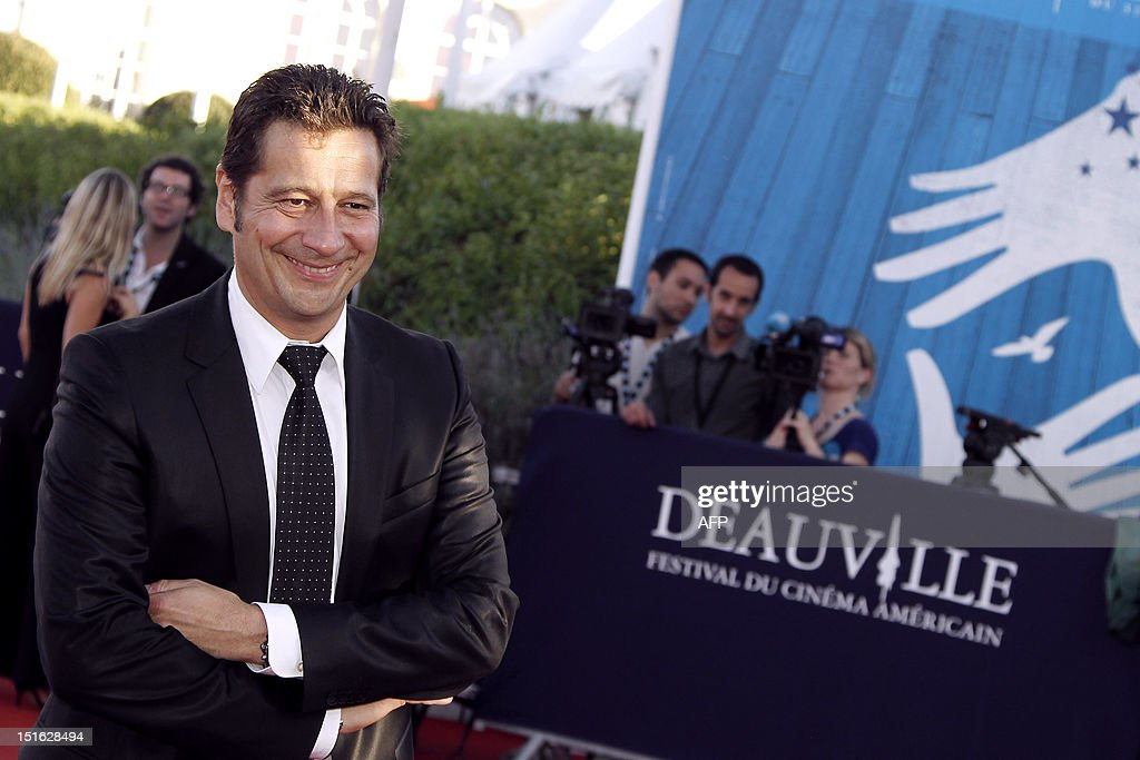 French humorist Laurent Gerra poses on the red carpet as she arrives to attend the awarding ceremony off the 38th Deauville's US Film Festival on September 8, 2012 in the French northwestern sea resort of Deauville. AFP PHOTO/CHARLY TRIBALLEAU