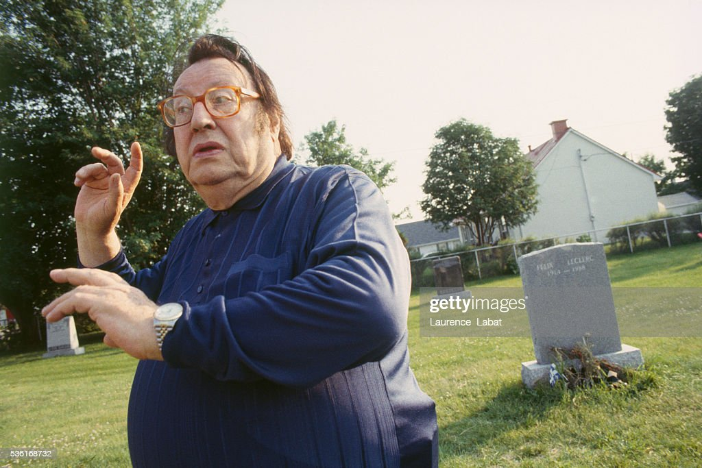 French humorist Raymond Devos during a visit to the grave of Canadian singer Felix Leclerc to film a special television show in homage to the...