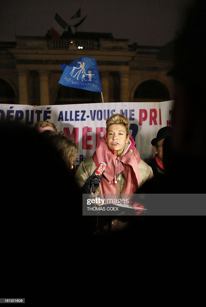 French humorist Virginie Tellene (C), aka 'Frigide Barjot,' speaks to the press in Paris on February 10, 2013 during a demonstration outside the Conseil d'Etat by predominantly French right wing supporters protesting a proposed law to legalise gay marriage and adoption. France's National Assembly overwhelmingly approved a key piece of legislation that will allow homosexual couples to marry and adopt children, to the delight of gay activists. AFP PHOTO / THOMAS COEX