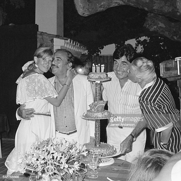 French humorists and actors Roger Pierre and JeanMarc Thibault kissed by his wife the French actress Sophie Agacinski during their 60th birthday...