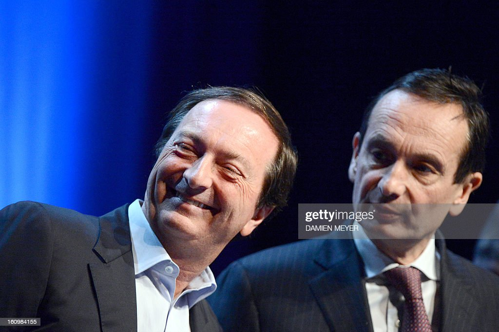 French hypermarket chain E. Leclerc's president Michel-Edouard Leclerc (L) and French retailing group Carrefour general secretary Jerome Bedier (R) attend a general meeting of the 'Made in Britanny' association in Saint-Malo, western France on February 8, 2013.