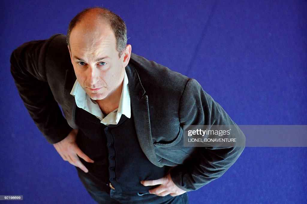 French illustrator Blutch poses on October 15 2009 in Bobigny near Paris during a ceremony as part of the 'Droles de Gaulois' event to honour French...