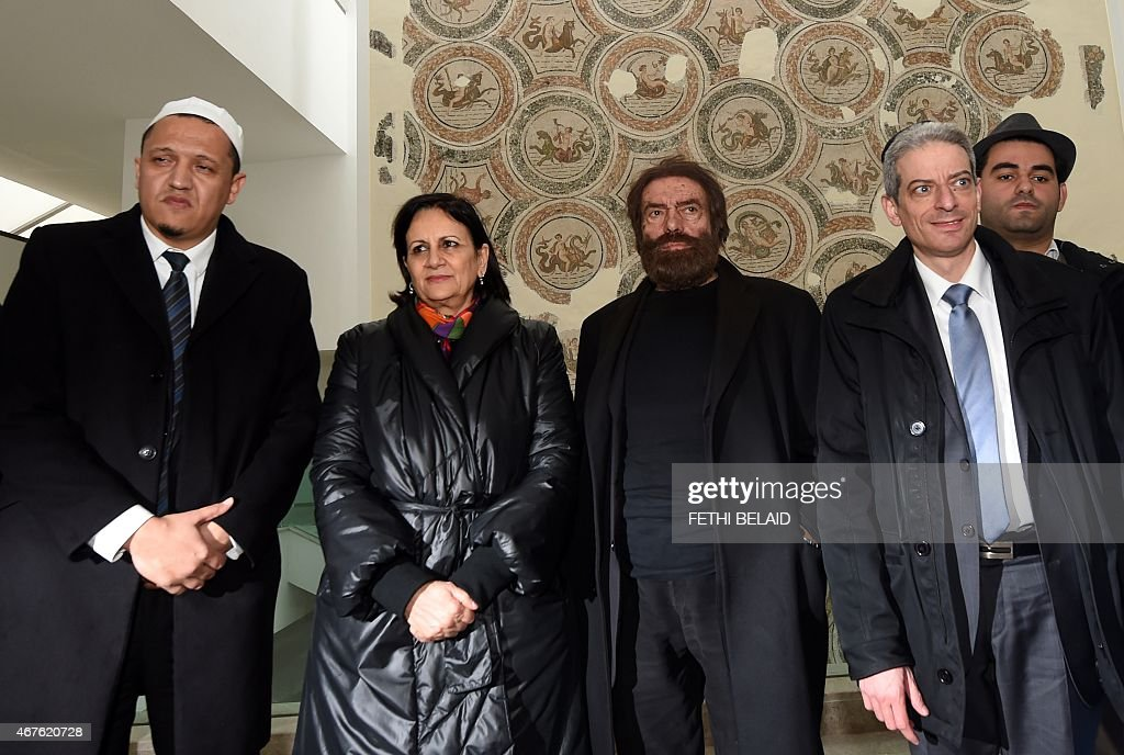 French Imam Hassen Chalghoumi, Tunisian Culture Minister Latifa Lakhdhar, French-Jewish writer <a gi-track='captionPersonalityLinkClicked' href=/galleries/search?phrase=Marek+Halter&family=editorial&specificpeople=768328 ng-click='$event.stopPropagation()'>Marek Halter</a> and French Rabbi Moshe Lewin arrive at the Bardo Museum in Tunis on March 26, 2015, in solidarity with victims of the Tunis' museum attack. Tunisia said that it had arrested 23 suspects in connection with last week's jihadist massacre at the country's national museum.