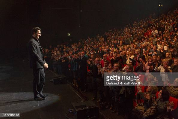 French impersonator Laurent Gerra acknowledges applause at the end of his One Man Show at Palais des Congres on November 30 2012 in Paris France