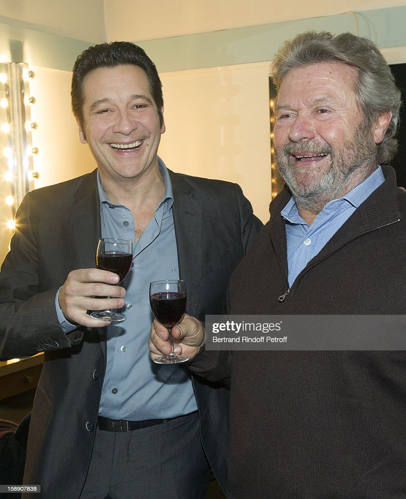 French impersonator Laurent Gerra (L) and Alain-Dominique Perrin share a light moment in Gerra's dressing room following his one man show at Olympia hall on December 26, 2012 in Paris, France.