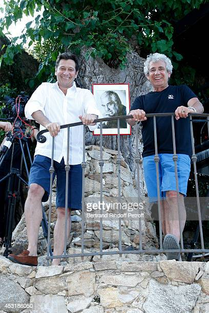 French impersonator Laurent Gerra and Artistic Director of the Festival Michel Boujenah pose front of the picture of JeanClaude Brialy during the...