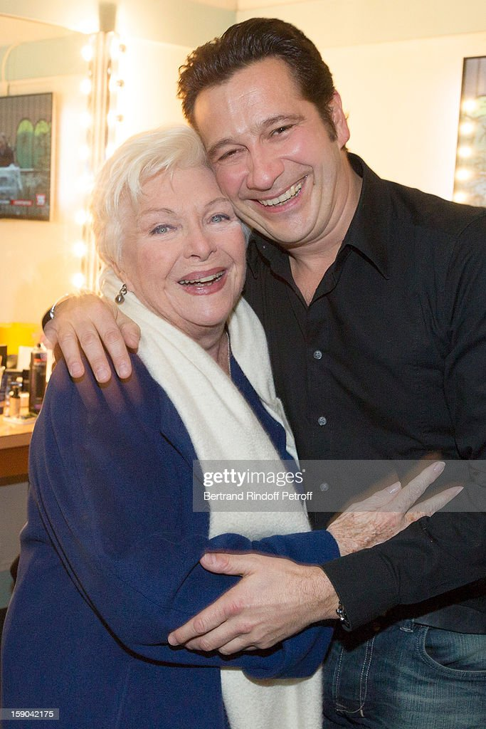French impersonator Laurent Gerra (R) and singer Line Renaud pose in Gerra's dressing room following his one man show at Olympia hall on January 4, 2013 in Paris, France.