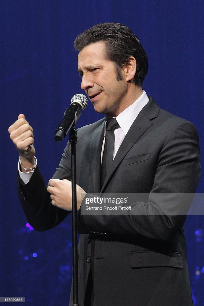 French impersonator Laurent Gerra imitates former French Culture Minister Jack Lang during his One Man Show at Palais des Congres on November 29, 2012 in Paris, France.