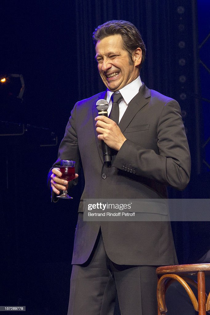 French impersonator <a gi-track='captionPersonalityLinkClicked' href=/galleries/search?phrase=Laurent+Gerra&family=editorial&specificpeople=538435 ng-click='$event.stopPropagation()'>Laurent Gerra</a> imitates former French President Nicolas Sarkozy during his One Man Show at Palais des Congres on November 28, 2012 in Paris, France.