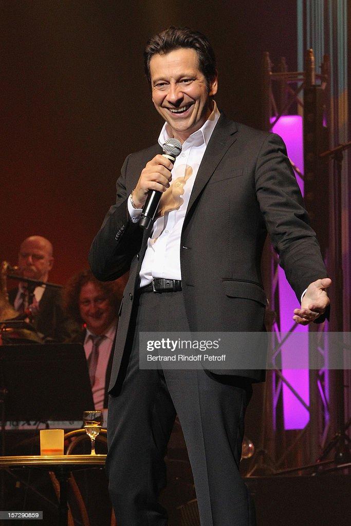 French impersonator Laurent Gerra imitates humorist Patrick Sebastien during his One Man Show at Palais des Congres on November 29, 2012 in Paris, France.