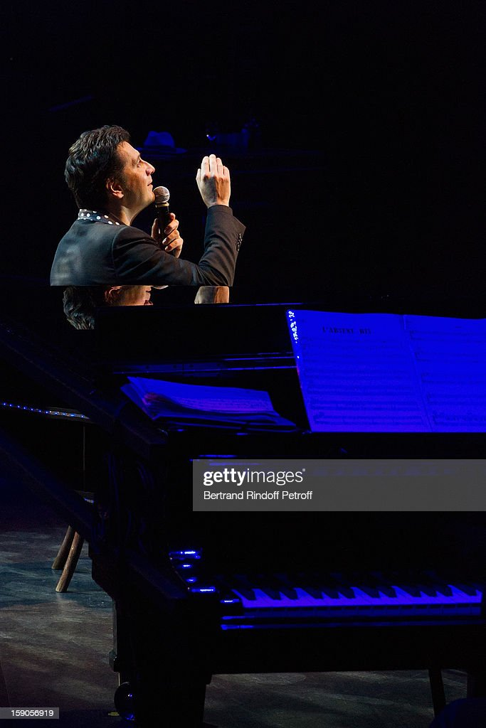 All captions used with this image must detail the personality being impersonated by Laurent Gerra) (FRANCE TABLOIDS OUT) French impersonator Laurent Gerra imitates late singer Gilbert Becaud during January 3, 2013 in Paris, France.