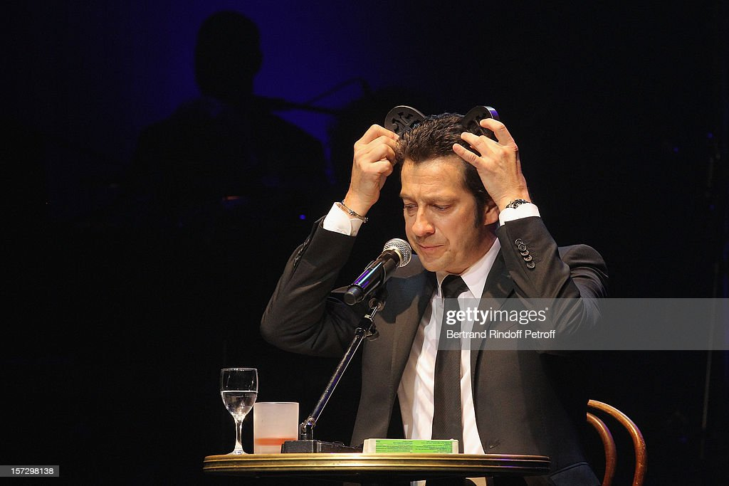 French impersonator <a gi-track='captionPersonalityLinkClicked' href=/galleries/search?phrase=Laurent+Gerra&family=editorial&specificpeople=538435 ng-click='$event.stopPropagation()'>Laurent Gerra</a> imitates Pierre Bellemare during his One Man Show at Palais des Congres on November 28, 2012 in Paris, France.