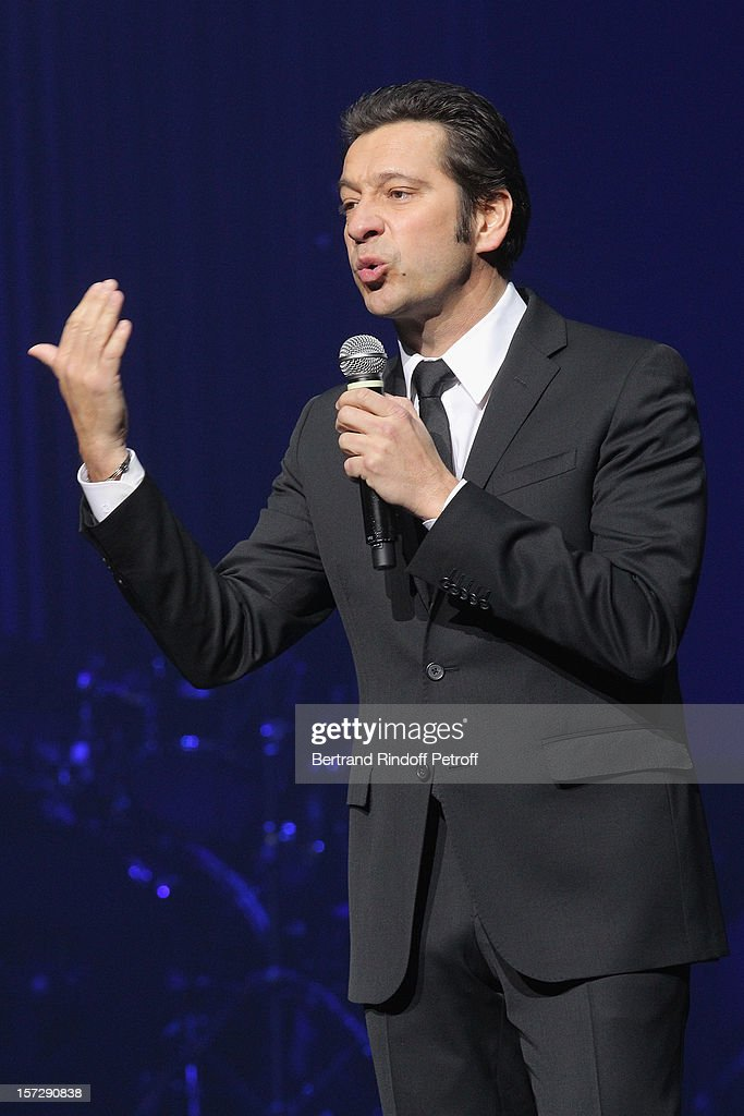French impersonator Laurent Gerra imitates singer Enrico Macias during his One Man Show at Palais des Congres on November 29, 2012 in Paris, France.