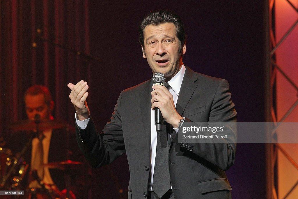 French impersonator Laurent Gerra imitates singer Enrico Macias during his One Man Show at Palais des Congres on November 28, 2012 in Paris, France.