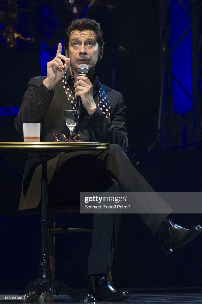French impersonator Laurent Gerra imitates singer Gilbert Becaud during his One Man Show at Palais des Congres on November 29, 2012 in Paris, France.