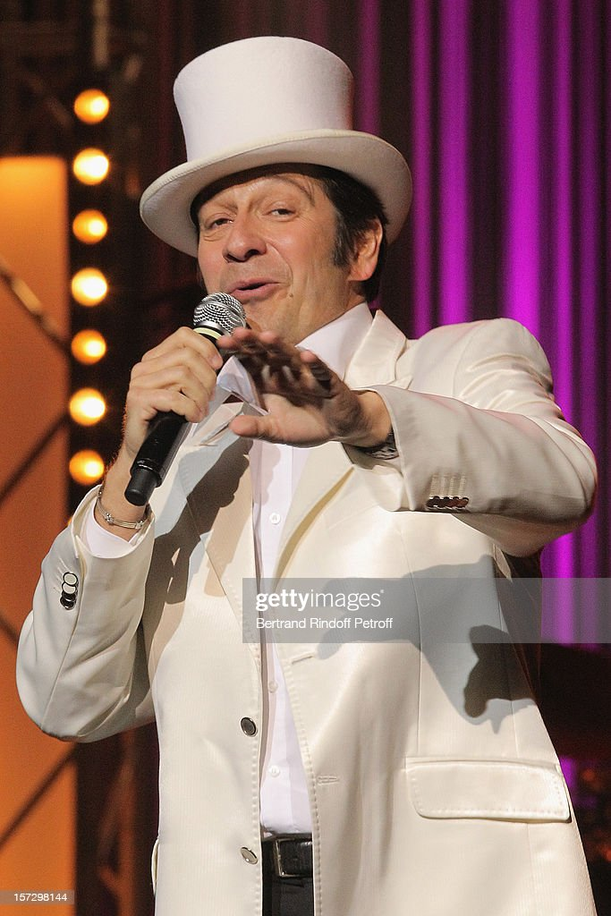 French impersonator Laurent Gerra imitates singer Henri Salvador during his One Man Show at Palais des Congres on November 28, 2012 in Paris, France.