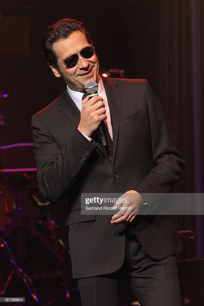 French impersonator Laurent Gerra imitates singer Jacques Dutronc during his One Man Show at Palais des Congres on November 29, 2012 in Paris, France.