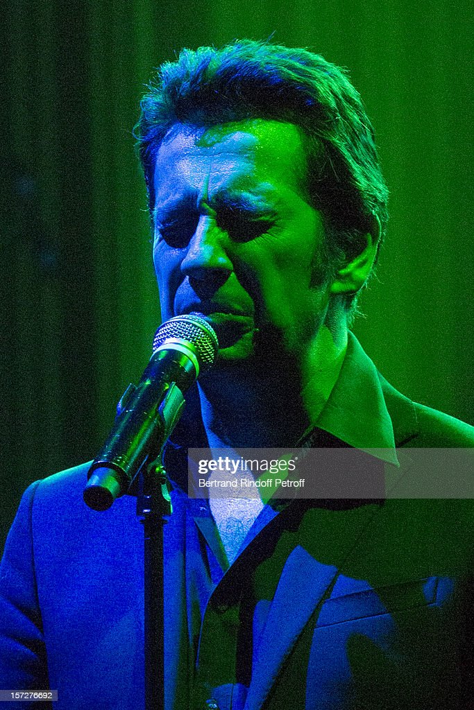 French impersonator <a gi-track='captionPersonalityLinkClicked' href=/galleries/search?phrase=Laurent+Gerra&family=editorial&specificpeople=538435 ng-click='$event.stopPropagation()'>Laurent Gerra</a> imitates singer Leo Ferre during his One Man Show at Palais des Congres on November 29, 2012 in Paris, France.